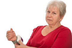 Woman is measuring blood pressure Stock Images