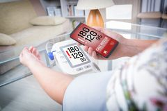 High blood pressure - calling for help with smart phone app Royalty Free Stock Photography