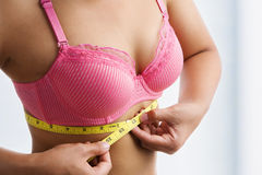 Woman measuring breast band size Stock Images