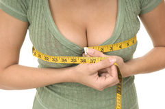 Woman measuring bust line Stock Photo