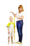 Woman measuring child Stock Photos