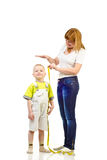 Woman measuring child Royalty Free Stock Photos
