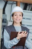 Woman measuring electrical current. Happy Stock Images