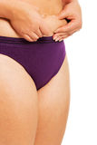 Woman measuring fat belly in underwear.  royalty free stock photography