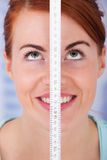 Woman Measuring Height With Measure Tape Stock Image