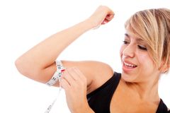 Woman measuring her arm Stock Photos