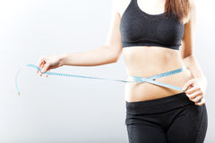 Woman measuring her belly after exercise Stock Images