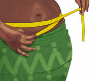 Woman measuring her belly Royalty Free Stock Photo