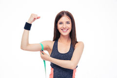 Woman measuring her biceps with measurement tape Stock Image