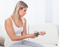 Woman measuring her blood pressure Royalty Free Stock Images