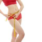 Woman measuring her body Royalty Free Stock Photos