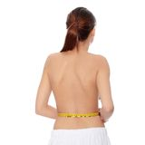 Woman measuring her body Stock Photography