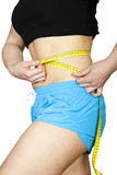Woman measuring her body. Woman measuring her slim body isolated on white stock photo