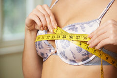 Woman Measuring Her Bra Size With Tape Measure Stock Image