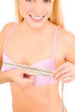 Woman measuring her breast with a tape Royalty Free Stock Photography