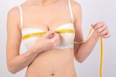 Woman measuring her breasts Stock Photography