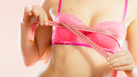 Woman measuring her breasts Royalty Free Stock Photos