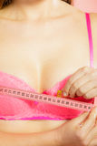 Woman measuring her breasts Stock Photos