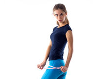 Woman measuring her buttocks Royalty Free Stock Photos