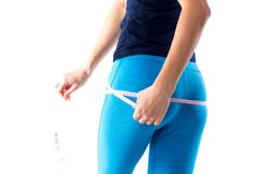Woman measuring her buttocks Stock Photography