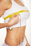 Woman measuring her chest Royalty Free Stock Image