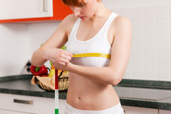 Woman measuring her chest with tape Stock Photography