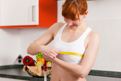 Woman measuring her chest with tape Stock Photos