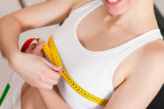 Woman measuring her chest with tape stock images