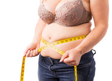 Woman measuring her fat belly Royalty Free Stock Photo