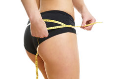Woman measuring her Hip Royalty Free Stock Photo
