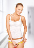 Woman measuring her hips. Picture of young beautiful woman measuring her hips Royalty Free Stock Photography