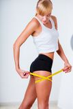 Woman measuring her hips Stock Image