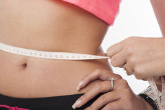 Woman measuring her perfect waist Stock Photo