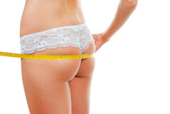 Woman measuring her rear Stock Images