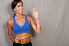 Woman measuring her shape from waist up Stock Photos