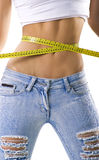 Woman measuring her small waist Royalty Free Stock Photos