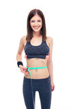 Woman measuring her tummy with a measuring tape Stock Images