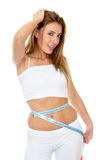 Woman measuring her waist Royalty Free Stock Photos