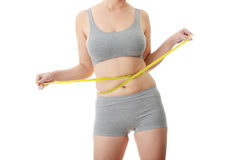 Woman measuring her waist Stock Images