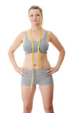 Woman measuring her waist Royalty Free Stock Photography