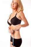 Woman measuring her waist Stock Photos
