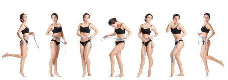 Woman measuring her waist by blue measure tape Royalty Free Stock Photography