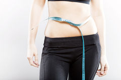 Woman measuring her waist after exercise Stock Images