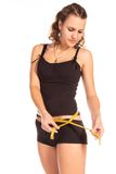 Woman measuring her waist. Healthy lifestyles concept Royalty Free Stock Photos