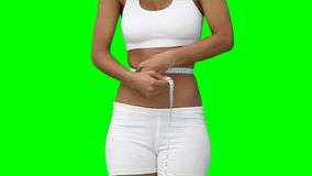 A woman measuring her waist line Royalty Free Stock Photo