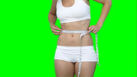 A woman measuring her waist line Royalty Free Stock Photography
