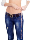 Woman measuring her waist over white Royalty Free Stock Images