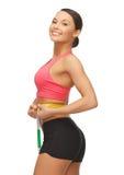 Woman measuring her waist Stock Image