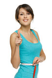 Woman measuring her waist and pointing at you Royalty Free Stock Photo