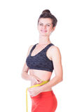 Woman measuring her waist Royalty Free Stock Images